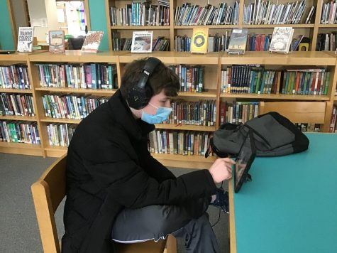 Ashton Lutz logs into his remote classes from the NRMS library. (photo Bradley Stagakis)