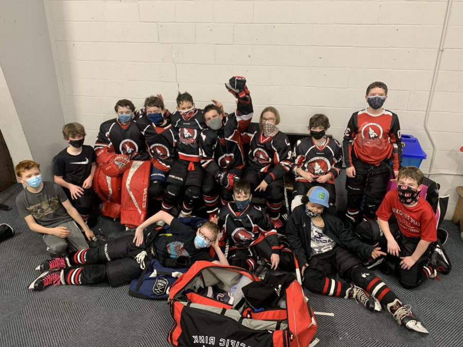 The Lower Cape Coyotes Pee Wee 1 Team celebrates their final game of the season.